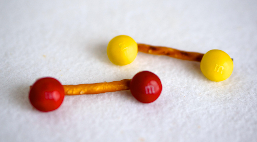 Barbells made with Birthday Cake M&Ms | Sweeterville.com